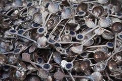 Ανασκόπηση των κουταλιών μετάλλων Στοκ Εικόνα