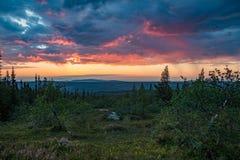 Ανατολή που λαμβάνεται από ένα βουνό στο εθνικό πάρκο fulufjellet Στοκ Εικόνα