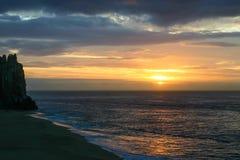 Ανατολή στη μέση των θυελλωδών σύννεφων σε Cabo SAN Lucas Στοκ Φωτογραφία