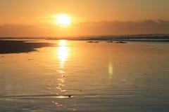 Ανατολή στο ανατολικό ακρωτήριο Νότια Αφρική κόλπων του Morgan Στοκ Εικόνα