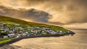 Ανατολή επάνω από Sandavagur, Νησιά Φερόες, Δανία στοκ εικόνα με δικαίωμα ελεύθερης χρήσης