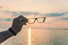 Ανατολή μέσω eyeglasses Στοκ Εικόνες