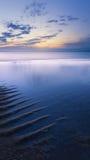Ανατολή στο νερό Στοκ Εικόνες