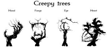 Ανατριχιαστικά δέντρα καθορισμένα στοκ εικόνα