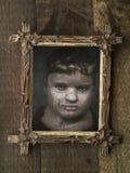 Ανατριχιαστική πλαισιωμένη αποκριές κούκλα Στοκ Εικόνες