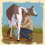 Αναδρομική αγελάδα αρμέγματος ατόμων Στοκ φωτογραφία με δικαίωμα ελεύθερης χρήσης