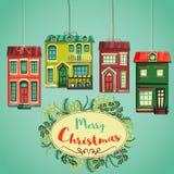 Αναδρομική κάρτα Χαρούμενα Χριστούγεννας Εκλεκτής ποιότητας σπίτια πόλεων κινούμενων σχεδίων και στεφάνι των εγκαταστάσεων Χριστο Στοκ φωτογραφία με δικαίωμα ελεύθερης χρήσης