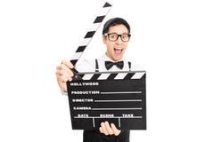 Αναδρομική τοποθέτηση τύπων πίσω από έναν κινηματογράφο clapperboard Στοκ φωτογραφία με δικαίωμα ελεύθερης χρήσης