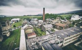 Αναδρομικό τονισμένο παλαιό εγκαταλειμμένο ανθρακωρυχείο Στοκ Εικόνα