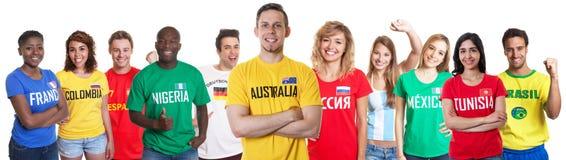 Ανεμιστήρας ποδοσφαίρου από την Αυστραλία με τους ανεμιστήρες από άλλες χώρες στοκ φωτογραφίες