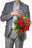 Ανθοδέσμη εκμετάλλευσης ατόμων των λουλουδιών γαρίφαλων Στοκ φωτογραφία με δικαίωμα ελεύθερης χρήσης