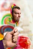 Ανθρώπινο πρόσωπο στο lollipop Στοκ φωτογραφία με δικαίωμα ελεύθερης χρήσης