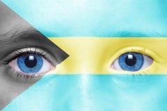 Ανθρώπινο πρόσωπο ` s με τη σημαία των Μπαχαμών Στοκ Φωτογραφίες
