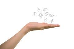 Ανθρώπινο χέρι που κρατά τα κοινωνικά εικονίδια Στοκ Φωτογραφία