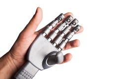 Ανθρώπινο χέρι που κρατά το ρομποτικό χέρι Στοκ φωτογραφίες με δικαίωμα ελεύθερης χρήσης