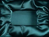 Ανοιγμένο μετάξι κιβώτιο ως υπόβαθρο Στοκ Εικόνες