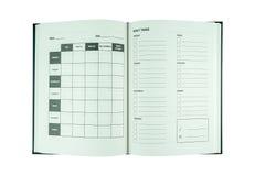 Ανοιγμένο σημειωματάριο τον προσωπικό διοργανωτή ή τον αρμόδιο για το σχεδιασμό που απομονώνεται με στο W στοκ εικόνες