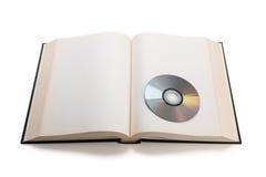 Ανοικτά βιβλίο και Compact-$l*Disk Στοκ εικόνα με δικαίωμα ελεύθερης χρήσης