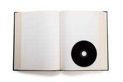 Ανοικτά βιβλίο και Compact-$l*Disk Στοκ Φωτογραφίες