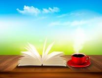 Ανοικτό βιβλίο και κόκκινο φλυτζάνι σε μια ξύλινη γέφυρα Στοκ εικόνα με δικαίωμα ελεύθερης χρήσης