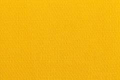 Ανοικτό κίτρινο υπόβαθρο ocher από ένα υφαντικό υλικό Ύφασμα με τη φυσική σύσταση backfill στοκ φωτογραφία