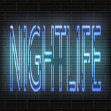 Ανοικτό μπλε επιστολές νέου - νυχτερινή ζωή στα πλαίσια ενός τουβλότοιχος τα διακοσμητικά πρόσωπα ανασκόπησης αφαίρεσης φιλούν το Στοκ φωτογραφία με δικαίωμα ελεύθερης χρήσης