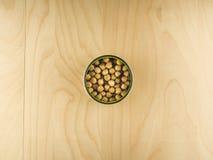 Ανοικτό δοχείο κασσίτερου με chickpeas, υγιεινή διατροφή Στοκ Εικόνα