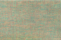 Ανοικτό πράσινο και κόκκινο υφαντικό υπόβαθρο με το σχέδιο σκακιού, κινηματογράφηση σε πρώτο πλάνο Δομή της μακροεντολής υφάσματο Στοκ Εικόνες