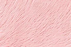 Ανοικτό ροζ υπόβαθρο από το μαλακό υφαντικό υλικό Ύφασμα με τη φυσική σύσταση Στοκ Εικόνες