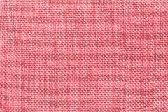 Ανοικτό ροζ υφαντικό υπόβαθρο με το ελεγμένο σχέδιο, κινηματογράφηση σε πρώτο πλάνο Δομή της μακροεντολής υφάσματος Στοκ φωτογραφία με δικαίωμα ελεύθερης χρήσης