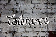Ανοχή λέξης στον τοίχο στοκ εικόνα με δικαίωμα ελεύθερης χρήσης