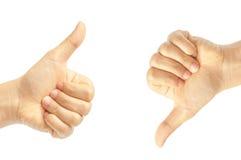 Αντίχειρας επάνω και αντίχειρας κάτω από τα σημάδια χεριών Στοκ Φωτογραφία