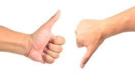 Αντίχειρας επάνω και αντίχειρας κάτω από τα σημάδια χεριών Στοκ φωτογραφίες με δικαίωμα ελεύθερης χρήσης