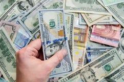 Αντίχειρας επάνω του δολαρίου και του ευρώ Στοκ Εικόνες