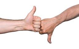 Αντίχειρες επάνω και αντίχειρες κάτω από τα σημάδια χεριών Στοκ εικόνες με δικαίωμα ελεύθερης χρήσης
