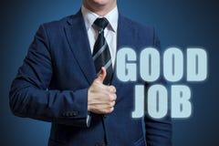 Αντίχειρες επιχειρηματιών επάνω με το καλό κείμενο εργασίας Επιχειρηματίας που παρουσιάζει αντίχειρες για την καλή εργασία φράσης στοκ εικόνες