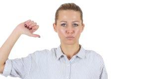 Αντίχειρες κάτω από τη επιχειρηματία, άσπρο υπόβαθρο Στοκ φωτογραφία με δικαίωμα ελεύθερης χρήσης