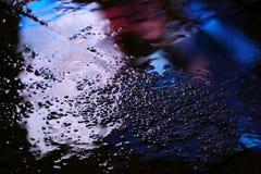 Αντανάκλαση σε μια λακκούβα μετά από τη διαφήμιση βροχής στοκ εικόνες με δικαίωμα ελεύθερης χρήσης
