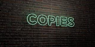 ΑΝΤΙΓΡΑΦΑ - ρεαλιστικό σημάδι νέου στο υπόβαθρο τουβλότοιχος - τρισδιάστατο δικαίωμα ελεύθερη εικόνα αποθεμάτων Στοκ Εικόνες