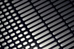 Αντιολισθητικό κατασκευασμένο σχέδιο στη βάση ανοξείδωτου της κυλιόμενης σκάλας Στοκ Φωτογραφίες