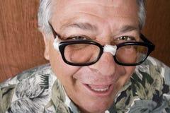 ανόητος ατόμων γυαλιών που δένεται με ταινία Στοκ φωτογραφία με δικαίωμα ελεύθερης χρήσης