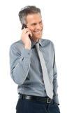 Ανώτερος επιχειρηματίας που συζητά στο τηλέφωνο Στοκ Εικόνες