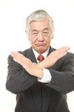 Ανώτερος ιαπωνικός επιχειρηματίας που δεν κάνει ΚΑΜΙΑ χειρονομία Στοκ Φωτογραφίες