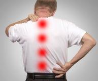 Ανώτερο ηλικιωμένο άτομο με τον πόνο στην πλάτη Στοκ Φωτογραφίες