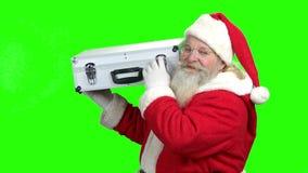 Ανώτερο Santa που παρουσιάζει σύνολο περίπτωσης των χρημάτων φιλμ μικρού μήκους