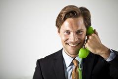 Απάντηση του τηλεφώνου Στοκ Φωτογραφίες