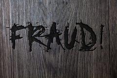 Απάτη κειμένων γραψίματος λέξης κινητήρια κλήση Επιχειρησιακή έννοια για την εγκληματική εξαπάτηση για να πάρει το οικονομικό ή π Στοκ φωτογραφία με δικαίωμα ελεύθερης χρήσης