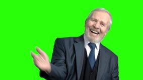 Απελπισμένος ανώτερος επιχειρηματίας, πράσινο υπόβαθρο απόθεμα βίντεο