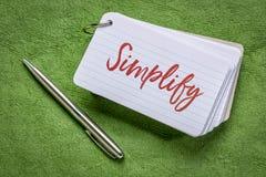 Απλοποιήστε τη λέξη σε μια κάρτα δεικτών στοκ φωτογραφία