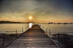 Αποβάθρα με το ηλιοβασίλεμα Στοκ Εικόνες